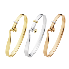 TORUN bangle set - sterling silver, 18 kt. yellow gold, rose gold and diamonds.