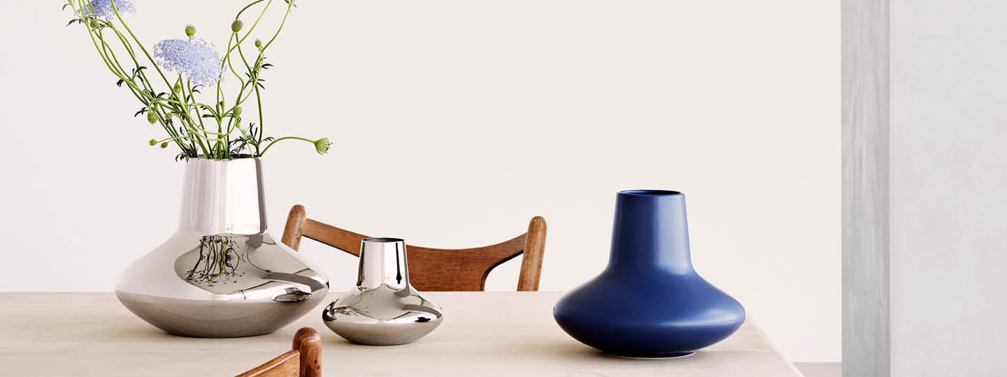 Henning Koppel vases in mirror-polished stainless steel and blue stoneware
