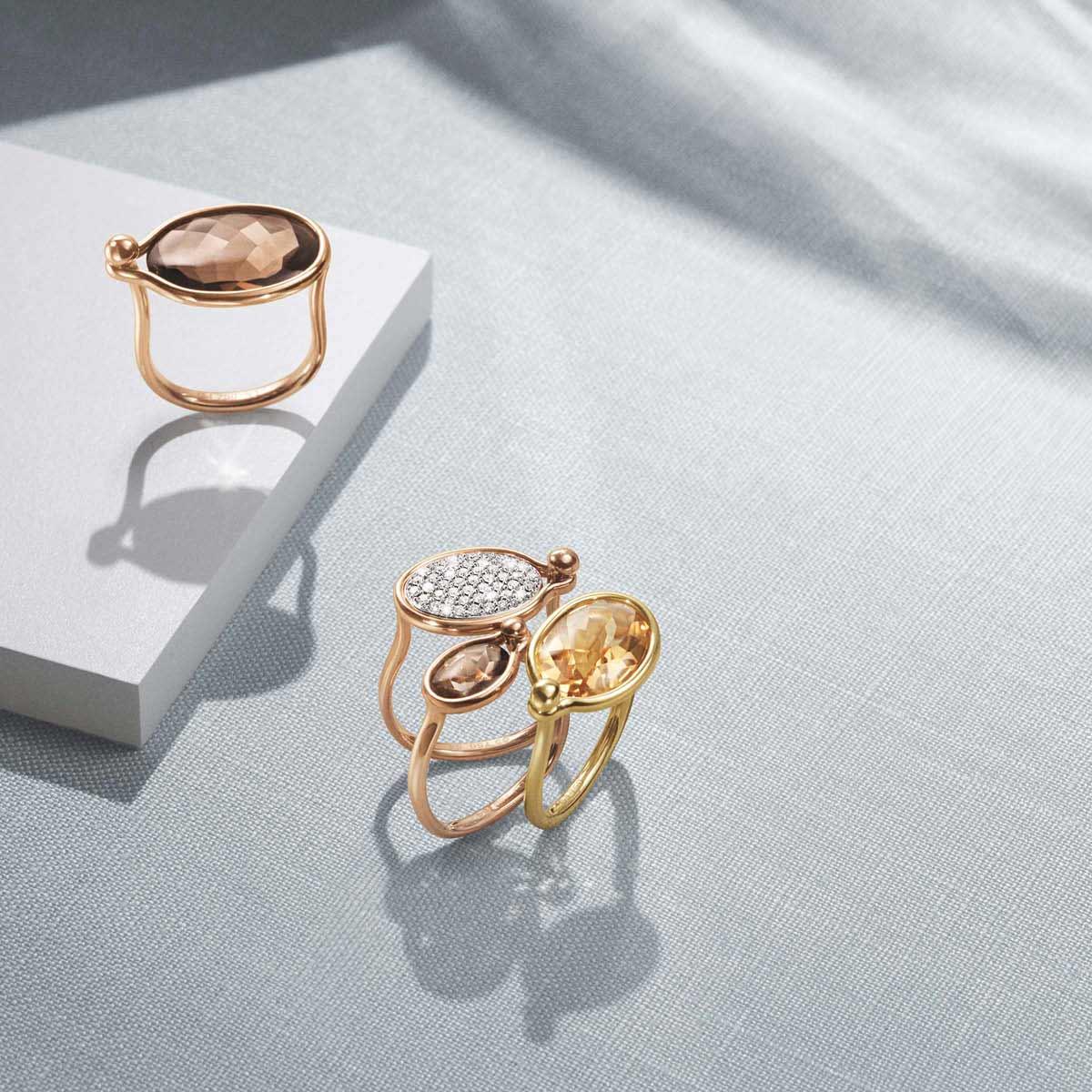Savannah rings (medium) in rose and yellow gold with smokey quartz, citrine and pavé set white diamonds and Savannah ring (small) in rose gold with smokey quartz
