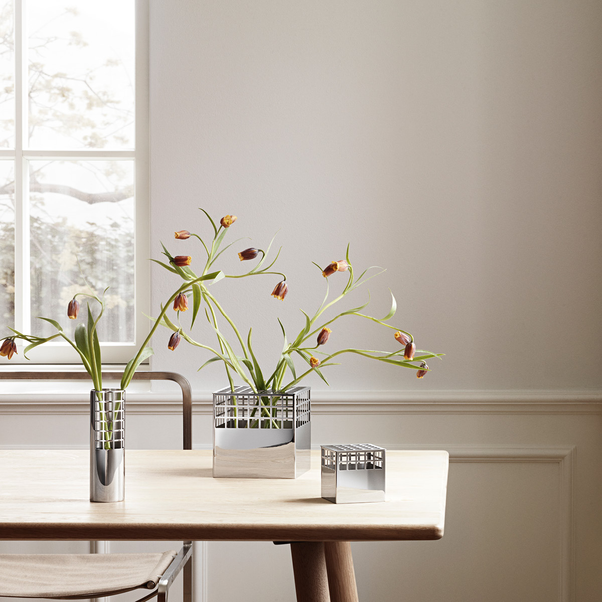 Matrix Tube Vase medium, Cube Vases medium and small in mirror polished stainless steel