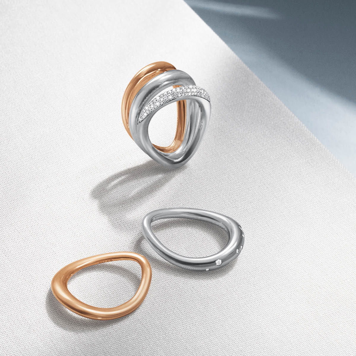 Offspring rings in rose gold and sterling silver with pavé set diamonds