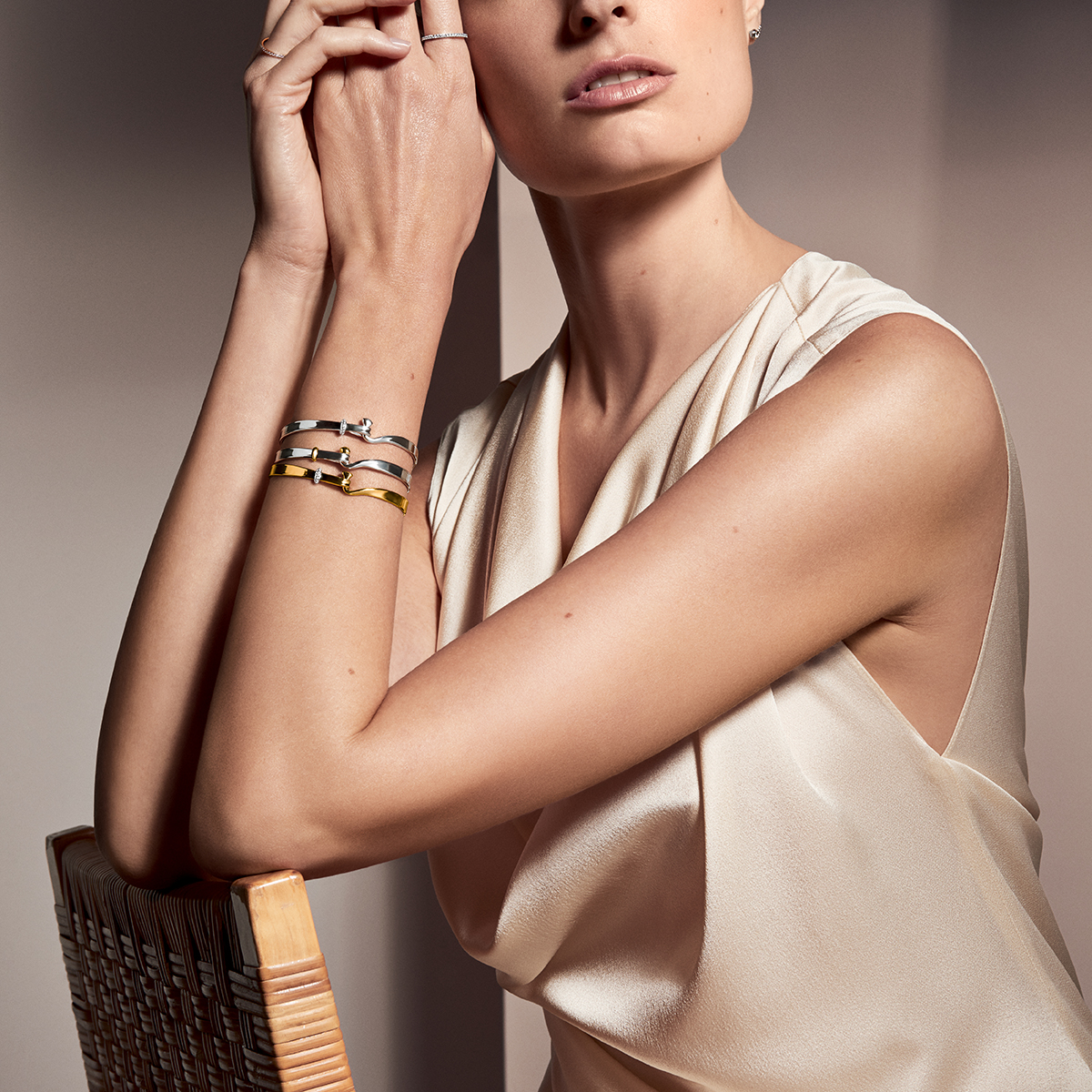 Three Torun bangles in sterling silver and yellow gold with brilliant cut diamonds