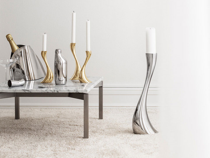 Cobra candleholders and floor candleholders (mirror-polished stainless steel and gold plated) and SKY cocktail shaker, jigger and stirring spoon (mirror-polished stainless steel) and Indulgence champagne cooler