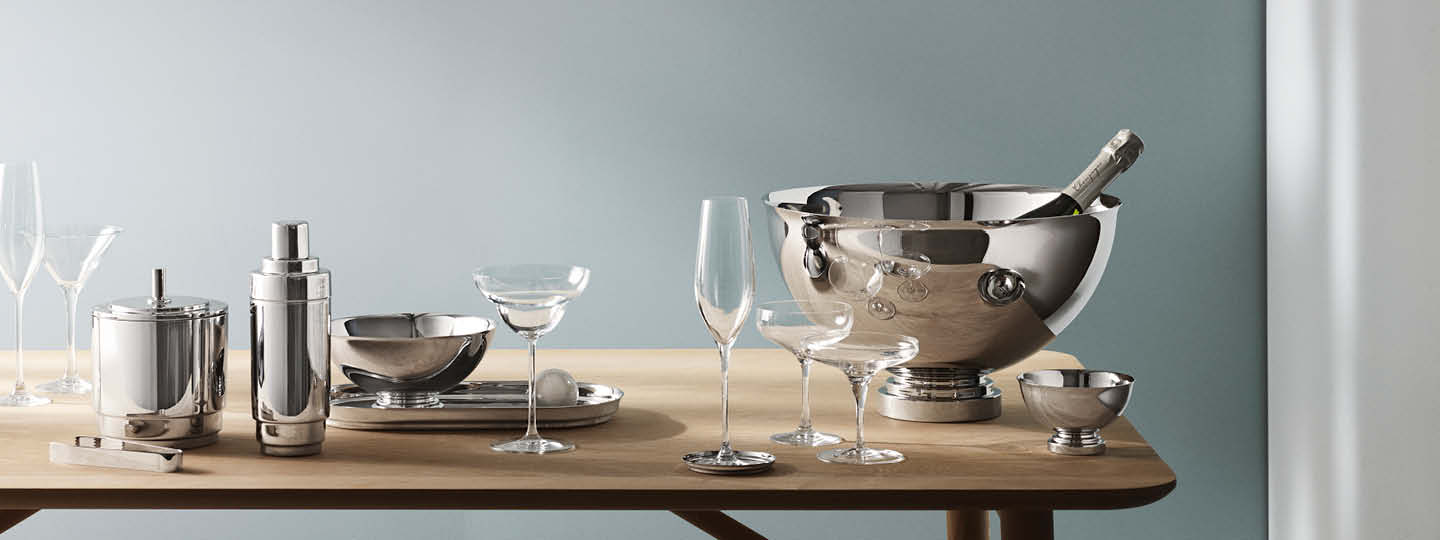 Manhattan champagne bowl, bowls, ice bucket with tongs, cocktail shaker and tray in mirror polished stainless steel