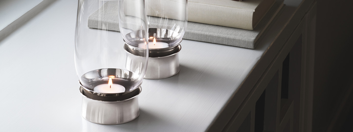 Lumis hurricane collection Danish design tealight candleholder from mouth-blown glass and stainless steel by Georg Jensen