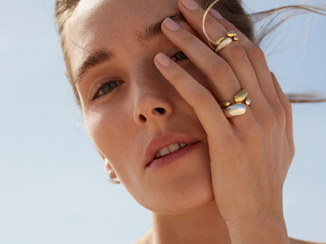 Georg Jensen Mercy collection 18 kt yellow gold with white diamonds and sterling silver ring combination of large and small