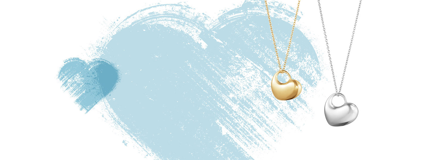 18 kt. gold and sterling silver heart shaped necklace with pendant from the Hearts of Georg Jensen collection