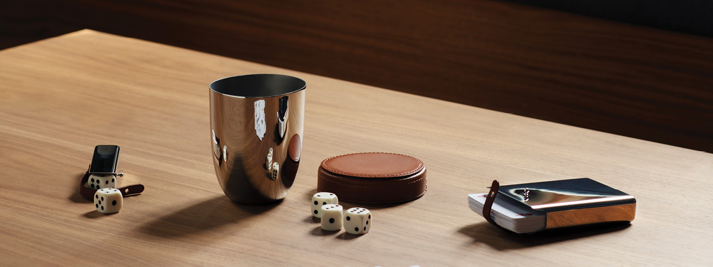 Dices, cardholder and game items from the Sky collection designed by Georg Jensen