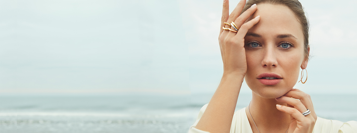 On model image of 18 kt. gold and sterling silver rings and earhoops from the Offspring collection designed by Jacqueline Rabun