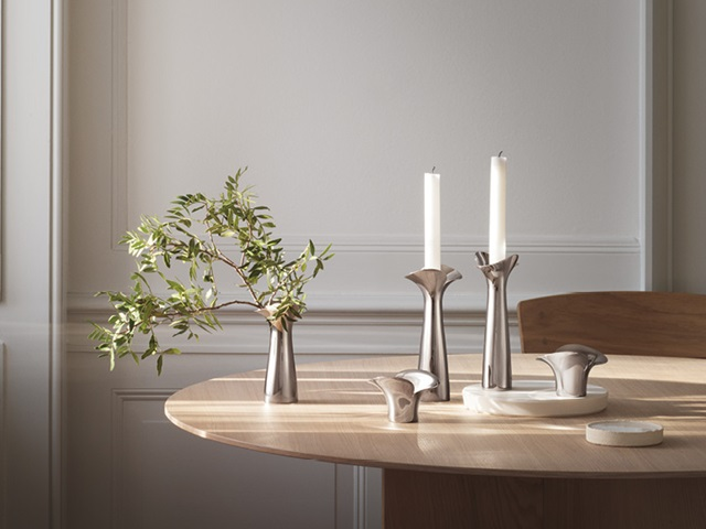 Bloom and Botanica collection Danish design mirror polished stainless steel tealight candleholders and vase by Georg Jensen