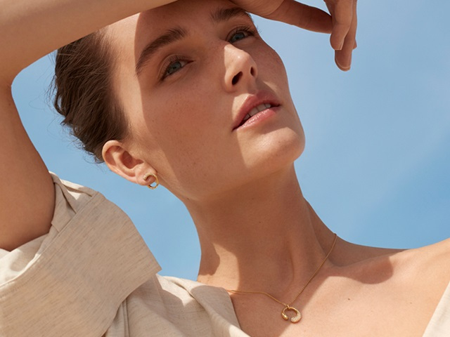 Georg Jensen Mercy collection 18 kt yellow gold pendant necklace, earrings and ring with white diamonds on model