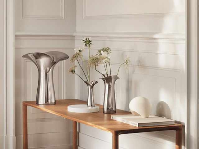 Bloom and Botanica collection Scandinavian home design mirror polished stainless steel large medium small vases Georg Jensen