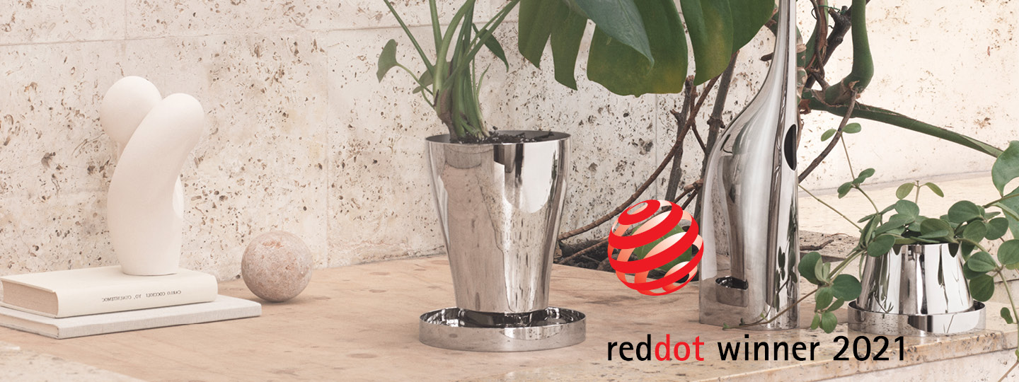 Red Dot 2021 award winning Mirror polished stainless steel watering can and terracotta planter from the Terra collection designed by Georg Jensen and Snøhetta