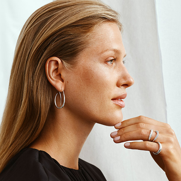 On model image with earring and rings in Sterling Silver with diamonds from the Offspring collection designed by Jacqueline Rabun