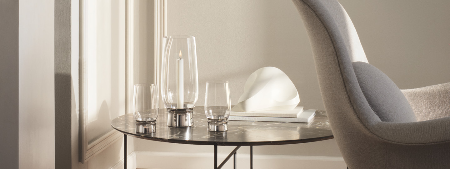 Lumis hurricane collection Scandinavian design candleholder from mouth-blown glass and stainless steel by Georg Jensen