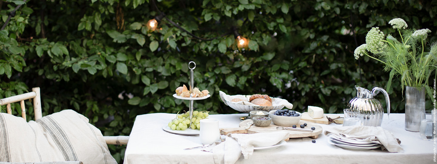 Mirror polished stainless steel and porcelain outdoor tablesetting featuring Bernadotte and Cobra collection