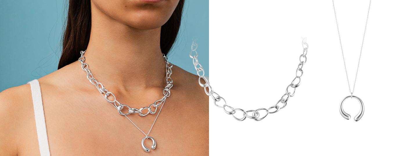 Mix of silver necklaces and pendants styled together by Georg Jensen
