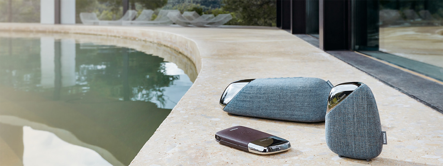 Georg Jensen X Philips collaboration with speakers in stainless steel and blue Kvadrat fabric