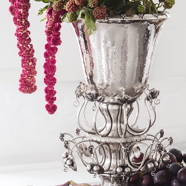 Image of the masterpiece Jardiniere 1505 in Sterling Silver containing flowers. Designed by Georg Jensen