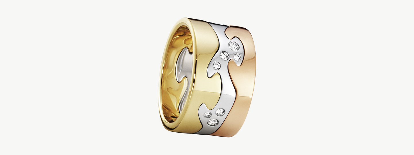 Fusion ring combination in 18kt. gold, sterling silver with diamonds and rosegold designed by Nina Koppel