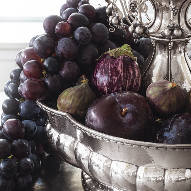 Image of the Jardiniere 1505 containing fruits. Designed by famous silver smithy Georg Jensen