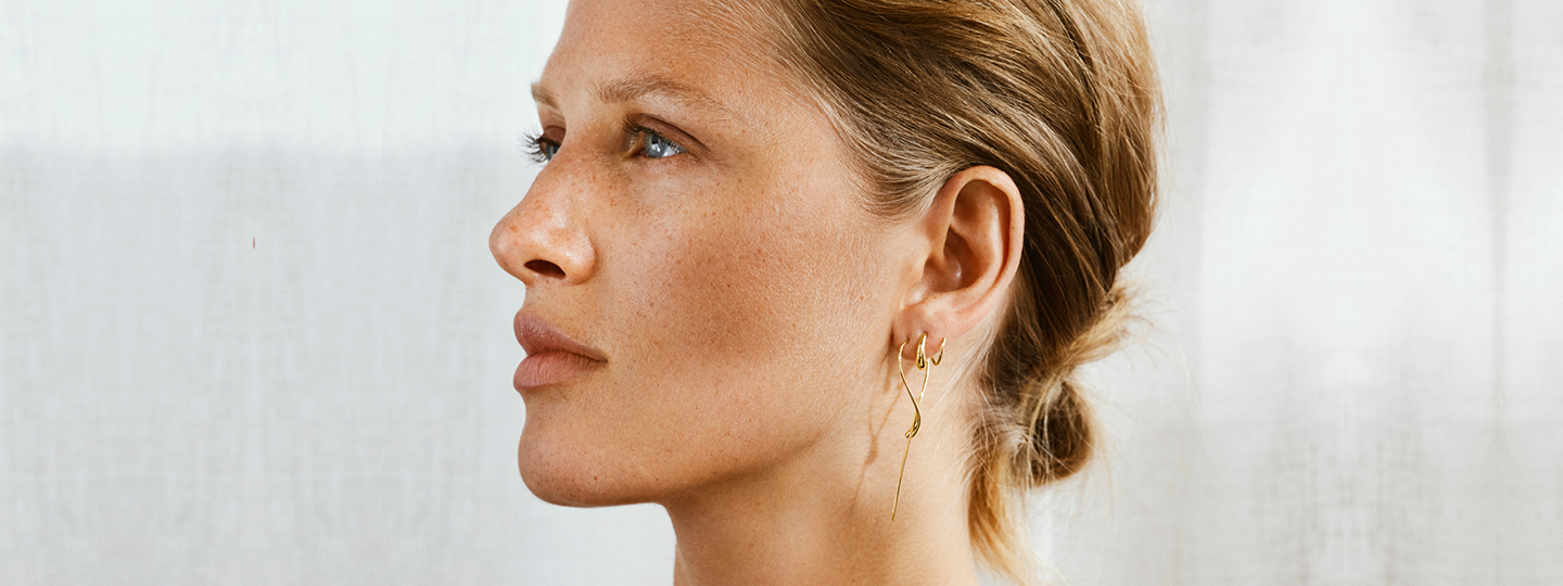 18 kt. gold earrings on model from the Mercy collection designed by Jacqueline Rabun