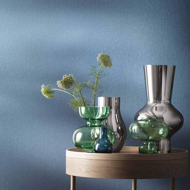Cafu vases in blue glass and mirror-polished stainless steel and Alfredo vases in green mouth-blown glass and mirror polished stainless steel