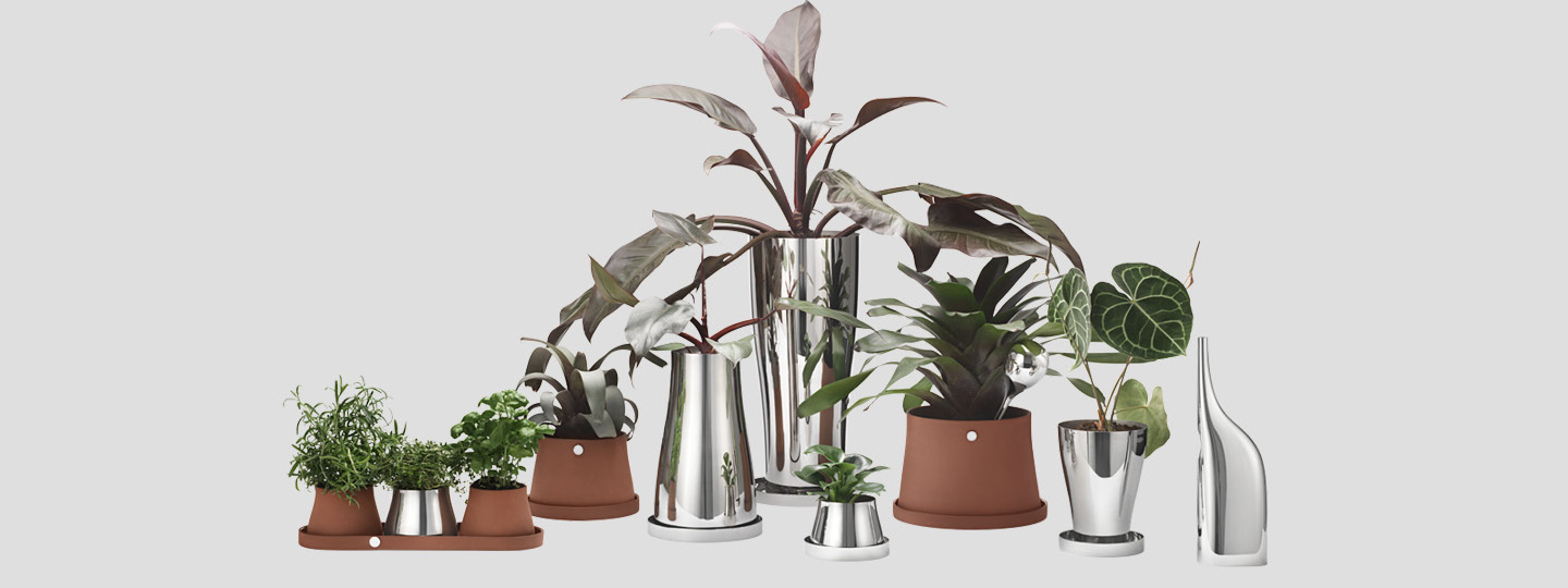 Pots and Vases from the terra collection in mirror polished stainless steel and terracotte from Georg Jensen designed by Swedish designer Snøhetta