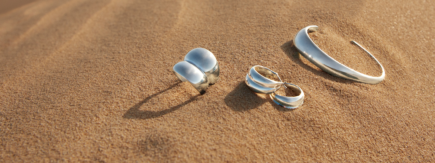 Scandinavian jewellery Georg Jensen Curve collection sterling silver ring earrings and bangle in nature sand setting