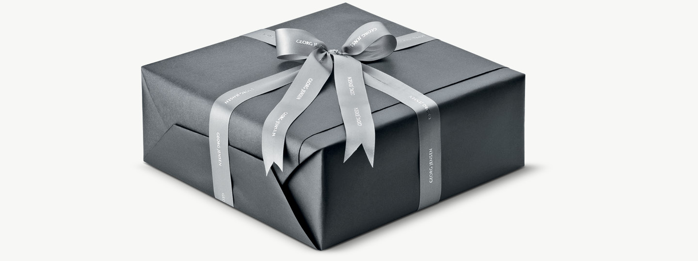 An example of a Georg Jensen present, gift wrapped with gift ribbons the Georg Jensen way