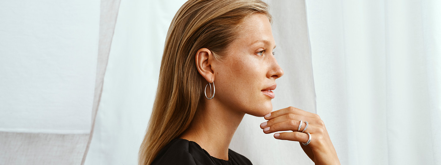 Silver earring on model as a Christmas gift inspiration from the Offspring collection for women designed by Georg Jensen