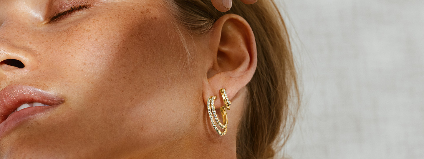 Earrings in 18 kt. gold with diamonds on model from the Halo collection designed by Sophie Bille Brahe