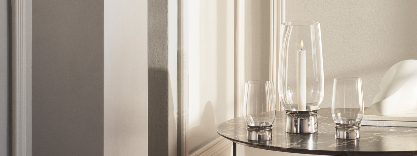 Mirror polished stainless steel candleholders in small, medium and large from the Lumis collection