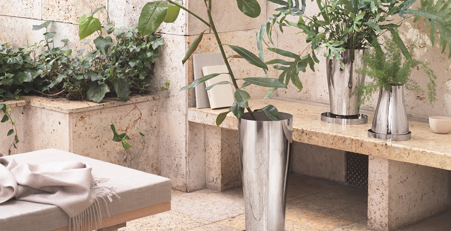 Pots and Planters in mirror polished stainless steel from the Terra collection by Georg Jensen designed by Swedish designer Snøhetta