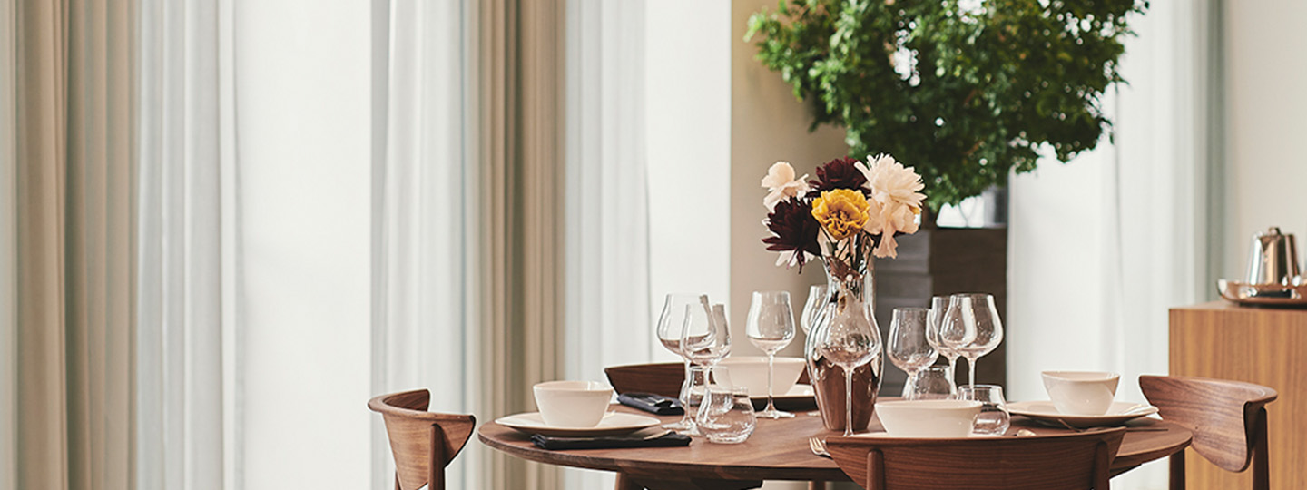 Crystal clear glasses and white porcelain plates from the Sky dining collection
