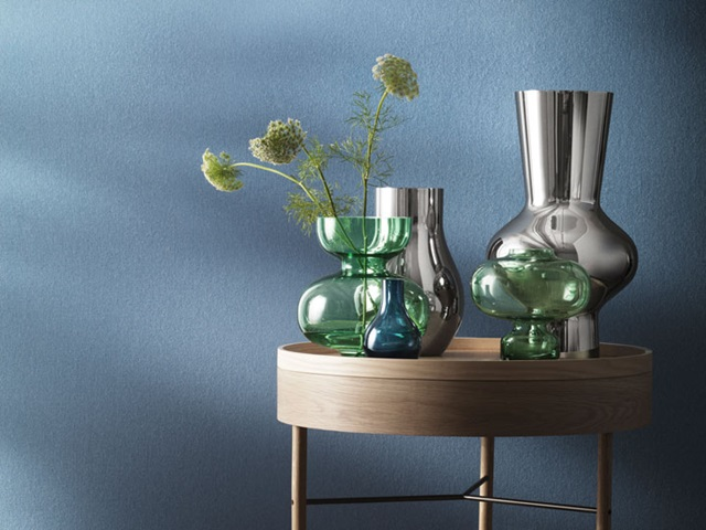 Cafu vases in blue glass and mirror polished stainless steel and Alfredo vases in green mouth-blown glass and mirror polished stainless steel