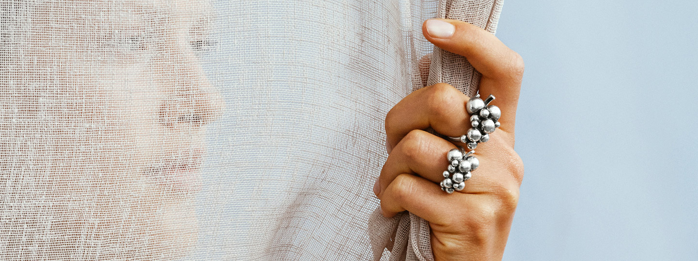 Oxidized sterling silver grapes inspired rings from the Moonlight Grapes collection by Georg Jensen