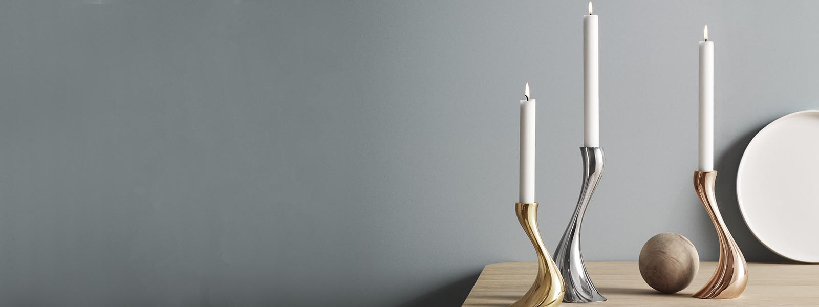 Candleholders in mirror polished stainless steel, plated rose gold and gold from the Cobra collection
