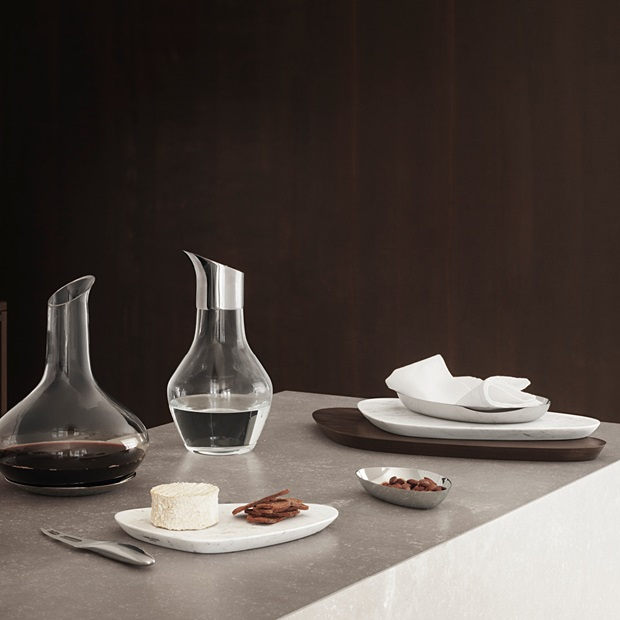 Sky Wine Carafe and Water Pitcher in handmade glass and stainless steel. Sky Serving Boards in marble and smoked oak. Sky Bowl small and medium in mirror polished stainless steel. Sky Cheese Knife in mirror polished stainless steel